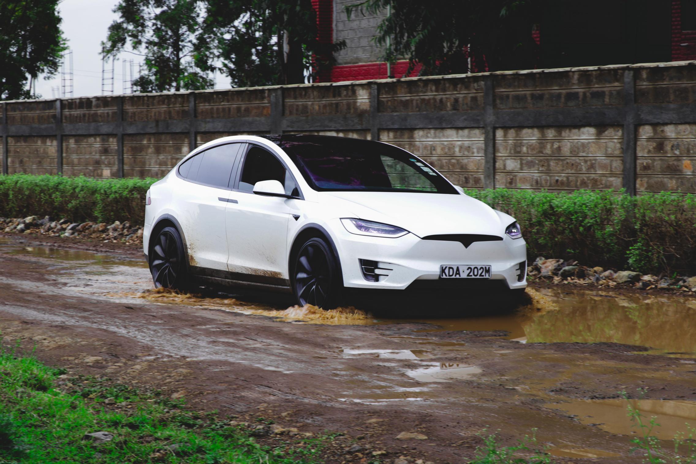Telsa Model X driving in mud
