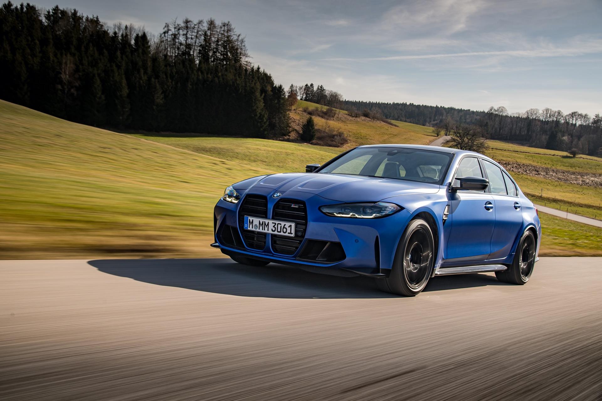 Portimao Blue BMW G80 M3 driving