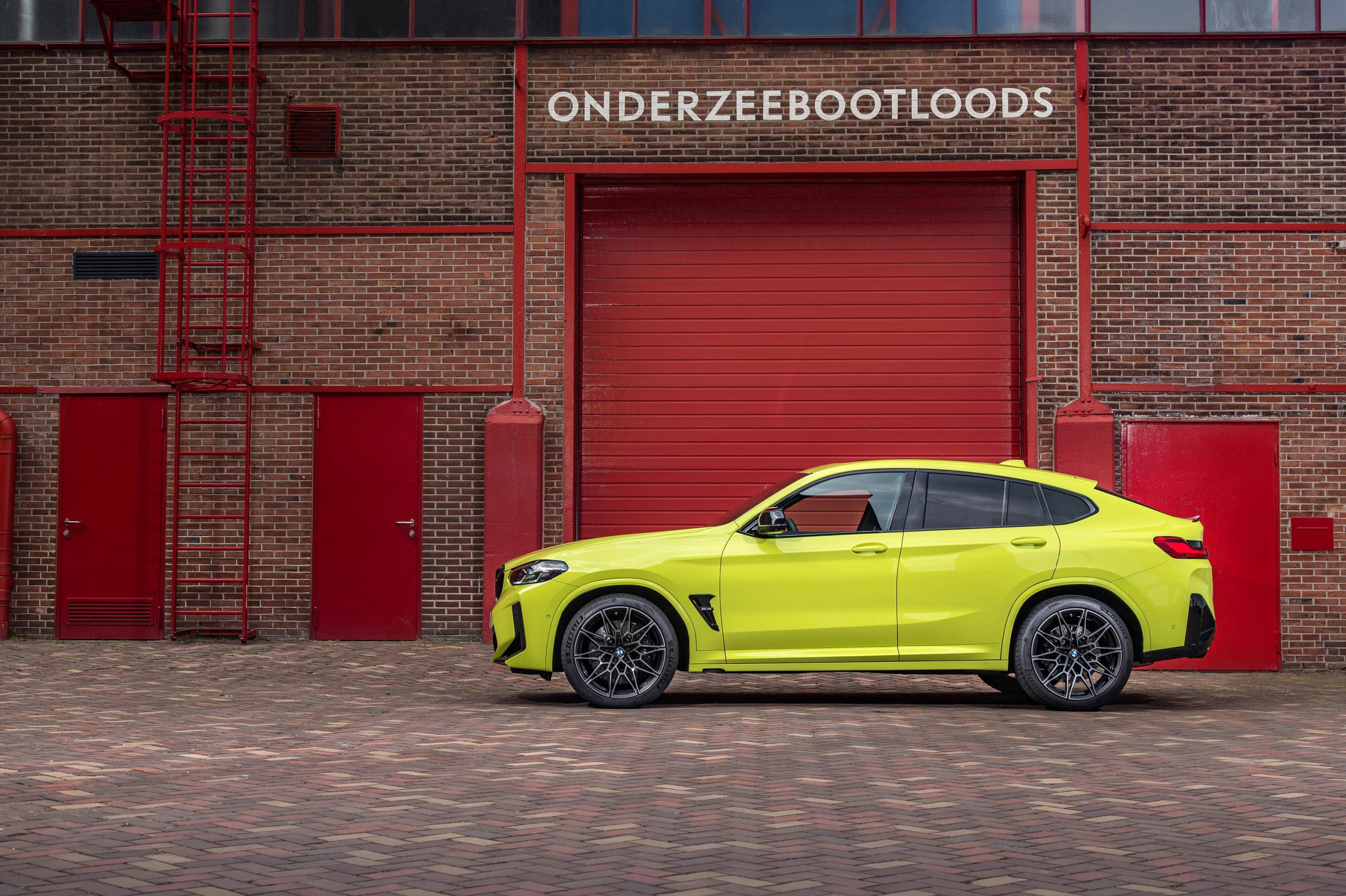 Yellow BMW X4 M Competition side